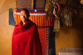 Tibetan Dhankar Monastery Monk Smiling Red