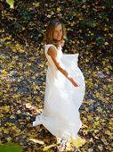 Happy Bride In White Dress In Autumn Defoliation poster