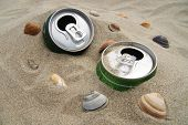 Cans in the sand