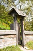 Old opened the wooden gate in rural areas
