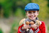 Mushrooms picking, season for mushrooms - lovely girl with picked fresh edible mushrooms