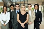 stock photo of team building  - portrait of modern business team inside office building - JPG
