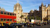 Black and yellow cabs in front of the Victoria Terminus. Mumbai