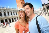 Portrait of cheerful couple in Venice, San Marco Place