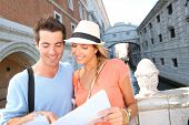 Couple looking at tourist guide by the Bridge of Sighs, Venice