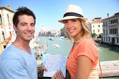 stock photo of academia  - Couplelooking at map on the Academia Bridge in Venice - JPG