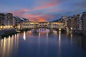 Ponte Vecchio Bridge At Sunset. Florence, Italy