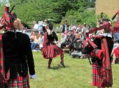 LONDON- JUNE 29: The dagenham girl pipers and drummers, perform in dagenham at one of the many Briti