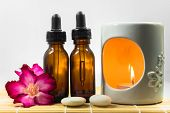 Aromatherapy oil and the candle with zen stones