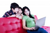 Family surfing internet on laptop - isolated