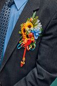 picture of boutonniere  - wedding boutonniere on suit of groom - JPG