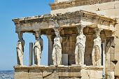 picture of stone sculpture  - The Erechtheion is an ancient Greek temple on the north side of the Acropolis of Athens in Greece which was dedicated to both Athena and Poseidon - JPG