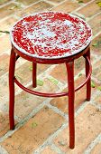 Old Metal Red Chair On Brick Floor