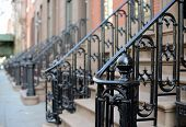 stock photo of brownstone  - Brownstone Apartment steps in the Chelsea neighborhood of New York City - JPG