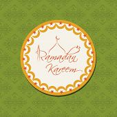 Ramadan Kareem tag, sticker or label on abstract green background.