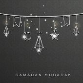 Holy month of muslim community Ramadan Kareem background with hanging arabic lanterns, stars and moon.
