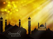 Silhouette of mosque on shiny abstract background for muslim community holy month of Ramadan Kareem,