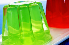 image of flavor  - closeup of a plate with refreshing gelatin desserts of different flavors and colors - JPG