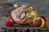 stock photo of rotten  - Old and rotten fruit on wooden board - JPG