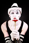 Portrait Of Mime With Red Gerbera Flower