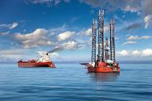 stock photo of offshoring  - Oil rig and tanker ship on offshore area - JPG