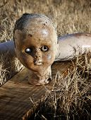 stock photo of baby doll  - Close up portrait of spooky abandoned old doll - JPG