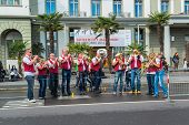Lucerne, Switzerland - OCT 27, 2013   A group of musicians lined the streets of Lucerne and play tra