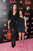 Khloe Kardashian and Kourtney Kardashian  at Barbie's 50th Birthday Party. Barbie's Real-Life Malibu Dream House, Malibu, CA. 03-09-09