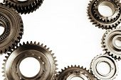 Steel cog gears on plain background. Copy space