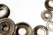 Steel cog gears on plain background. Copy space