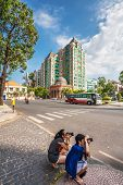 HO CHI MINH, VIETNAM - APRIL 28, 2014: Tourists take pictures on street in Ho Chi Minh City. Its for