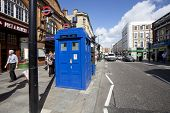 LONDON - JUNE 11, 2014: Public call police box with mounted a modern surveillance camera near Earl's