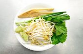 foto of soybean sprouts  - Mix of Thai Vegetable Bean sprout lime banana blossom and Garlic chives on white plate - JPG