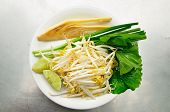 stock photo of lime-blossom  - Mix of Thai Vegetable Bean sprout lime banana blossom and Garlic chives on white plate - JPG