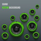 Green Sound Load Speakers on dark background.