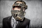 Frustration, aggressive executive suit and tie, Mexican wrestler mask
