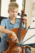 Boy playing cello at home