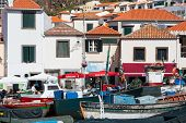 Harbor With Restaurants And Fishing Ships At Madeira