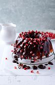 Upside-Down Cake with Chocolate Glaze and Pomegranate Seeds