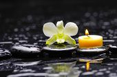 white orchid with candle and therapy stones reflection