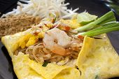 Pad Thai Ho-Kai, fried noodles with shrimps in Omlette,