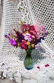 stock photo of digitalis  - still life bouquet with pink and blue bright flowers - JPG