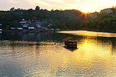 Sunset On Floating House