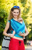 image of sling bag  - Young mother and baby in a sling - JPG