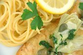 stock photo of artichoke hearts  - Delicious gourmet chicken piccata with noodles - JPG