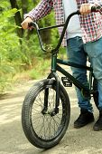 Young boy on BMX bike at park