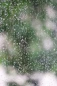 Rain water drops on window glass