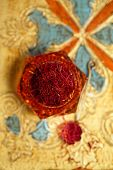 picture of saffron  - saffron spice in antique vintage glass bowl - JPG