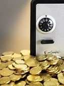 coins in front of the mini safe box