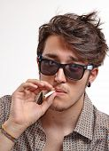 image of vicious  - Smoking man portrait wearing sunglasses - JPG